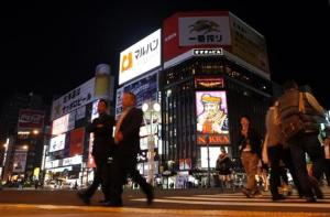 People walk along a pedestrians' crossing at Susukino shopping and amusement district in Sapporo