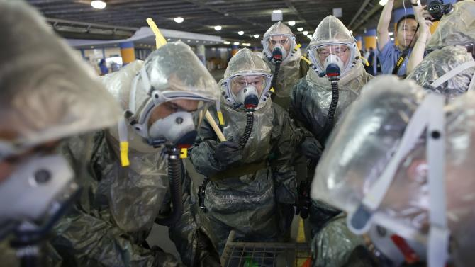 Members of a delegation from China take part in a chemical warfare drill in Jerusalem