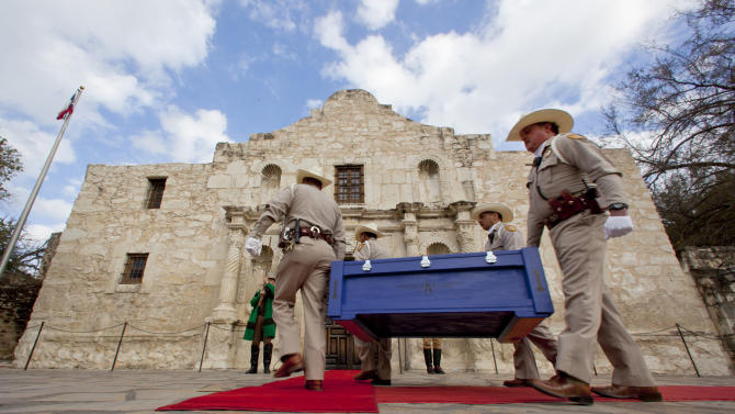 """The famous """"Victory or Death"""" letter penned on February 24, 1836 by William Barret Travis, Commander of the Texian rebels in the former mission known as the Alamo, is carried Friday Feb. 22, 2013 to the Alamo by Alamo Rangers in San Antonio. The letter is returning to the Alamo for the first time since it was dispatched by Travis during the battle. It will be on display until March 7. (AP Photo/San Antonio Express-News, William Luther) RUMBO DE SAN ANTONIO OUT; MAGS OUT; NO SALES; MANDATORY CREDIT"""