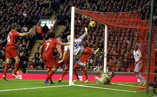 Liverpool's Mamadou Sakho, back, scores his side's second goal during their English Premier League soccer match at Anfield, Liverpool, England, Saturday, Dec. 7, 2013