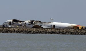 The wreckage of Asiana Flight 214, which crashed on …
