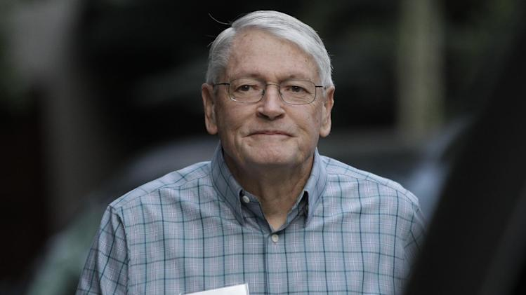FILE - In this Wednesday, July 11, 2012, file photo, John Malone. chairman of Liberty Media and CEO of Discovery Holding Company. arrives at the Allen & Company Sun Valley Conference in Sun Valley, Idaho. Liberty Global Inc., the cable TV operator controlled by Malone, announced Wednesday, Feb. 6, 2013, it s buying U.K.-based Virgin Media Inc. in a $16 billion deal that steps up the rivalry between Malone and fellow billionaire Rupert Murdoch. (AP Photo/Paul Sakuma, File)