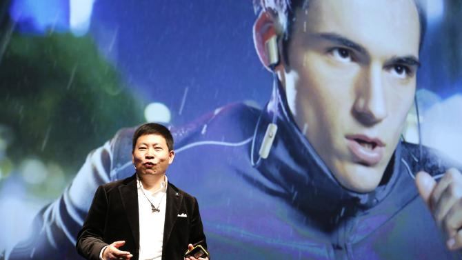 Huawei Chief Executive Richard Yu presents the TalkBand N1 during a news conference in Barcelona