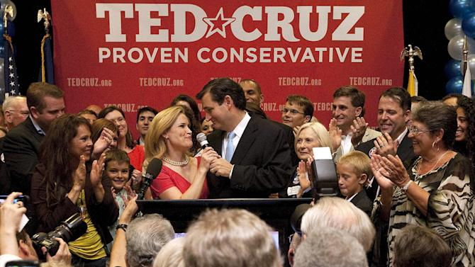 U.S. Senate candidate Ted Cruz thanks his wife, Heidi, in front of a cheerful crowd after he defeated Republican rival, Lt. Gov. David Dewhurst, in a runoff election for GOP nomination for the U.S. Senate seat vacated by the retiring Kay Bailey Hutchison, Tuesday, July 31, 2012, in Houston. (AP Photo/Houston Chronicle, Johnny Hanson) MANDATORY CREDIT