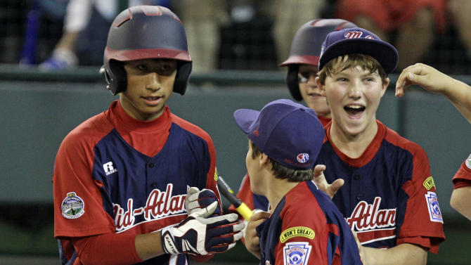 Parsippany, NJ.'s Emil Matti, left, is greeted by teammates after hitting a solo-home run off Gresham, Ore. pitcher Brett Falkner in the second inning of an elimination baseball game at the Little League World Series tournament in South Williamsport, Pa., Saturday, Aug. 18, 2012. It was Matti's second homer of the game. (AP Photo/Gene J. Puskar)
