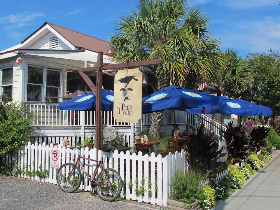 Poe's Tavern, a restaurant on Sullivans Island, S.C., is seen in this Sept. 12, 2013 photo. The restaurant is one of about a dozen on Sullivans Island just outside Charleston, S.C. (AP Photo/Bruce Smith)