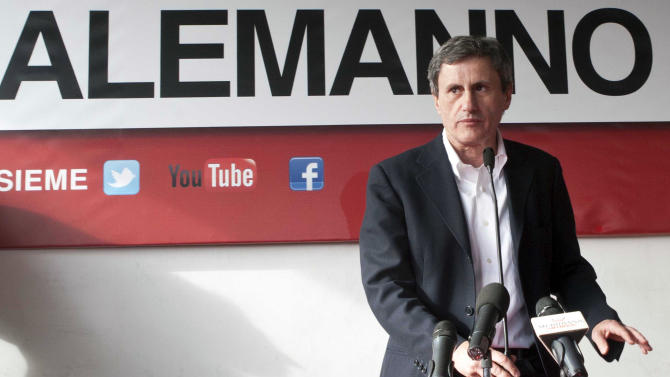 Rome Mayor Gianni Alemanno meets reporters in Rome, Monday, May 27, 2013. Projections indicate that Silvio Berlusconi's candidate in Rome's mayoral elections appears headed for a runoff in balloting that saw a low turnout.  Rome was the only big city up for grabs among some 500 towns in elections Sunday and Monday. Projections on 20 percent of the ballots by the Tecne polling company indicated that Mayor Gianni Alemanno, a conservative backed by Berlusconi for a second term, had about 30 percent of the vote, some 10 percentage points behind center-left challenger Ignazio Marino. (AP Photo/Mauro Scrobogna, Lapresse)