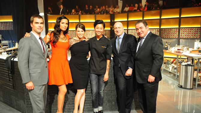 "In this publicity image provided by Bravo, ""Top Chef: Seattle"" winner, chef Kristen Kish, third right, poses with judges, from left, Hugh Acheson, Padma Lakshmi, Gail Simmons, Tom Colicchio, and Emeril Lagasse after show's finale that aired Wednesdays, Feb. 27, 2013. The 28-year-old chef de cuisine at Boston restaurant Stir was crowned champion of the Bravo cooking competition Wednesday after facing off against Brooke Williamson, the 34-year-old co-executive chef of Los Angeles restaurants Hudson House and The Tripel. (AP Photo/Bravo, David Moir)"