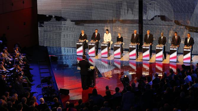 Presidential candidates, left to right, Zuzana Roithova, Jan Fischer, Jana Bobosikova, Tatana Fischerova, Premysl Sobotka, Milos Zeman, Vladimir Franz, Jiri Dientsbier and Karel Schwarzenberg attend a television debate in Prague, Czech Republic, Thursday, Jan. 10, 2013.   The Czech Republic holds the first round of the Presidential election on Jan. 11-12th, 2013. (AP Photo/Petr David Josek)