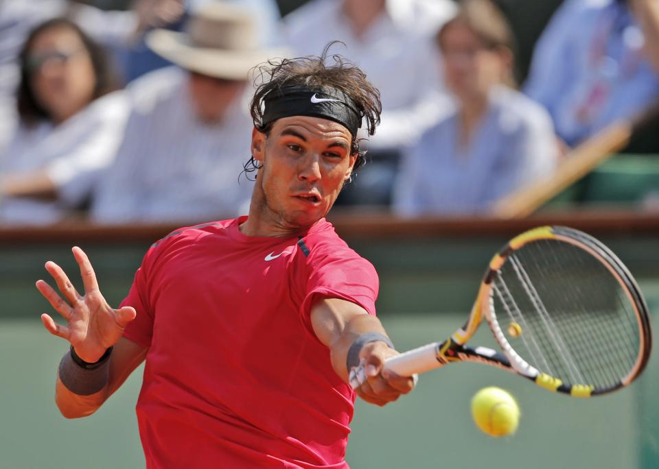 Defending champion Spain's Rafael Nadal returns the ball to Italy's Simone Bolelli during their first round match in the French Open tennis tournament at the Roland Garros stadium in Paris, Tuesday, May 29, 2012. (AP Photo/Christophe Ena)