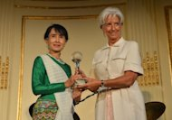 "Aung San Suu Kyi, Nobel Peace Prize Laureate, receives the Atlantic Council 2012 Global Citizen Award from Christine Lagarde, Managing Director of the International Monetary Fund, on September 21. Lagarde said she was ""intimidated"" by Suu Kyi's kindness and spirituality"