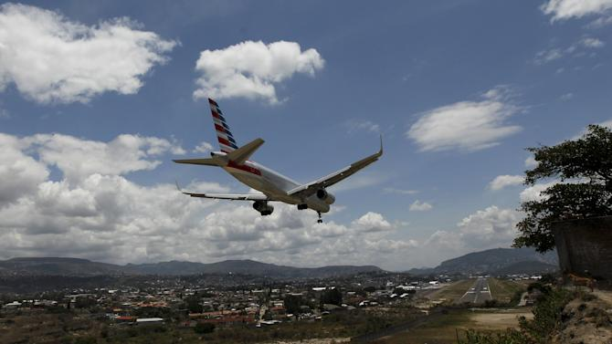 Plane approaches to land at Toncontin international airport in Tegucigalpa