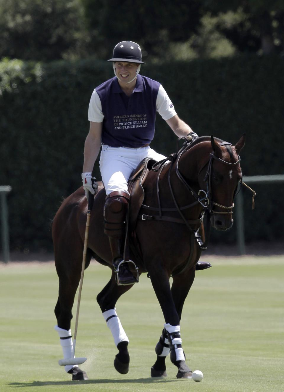 Prince William, Duke of Cambridge warms up prior to the charity polo match at The Santa Barbara Polo & Racquet club on Saturday, July 9, 2011 in Carpinteria Calif.  The event is held in support of The American Friends of The Foundation of Prince William and Prince Harry. (AP Photo/Reed Saxon)