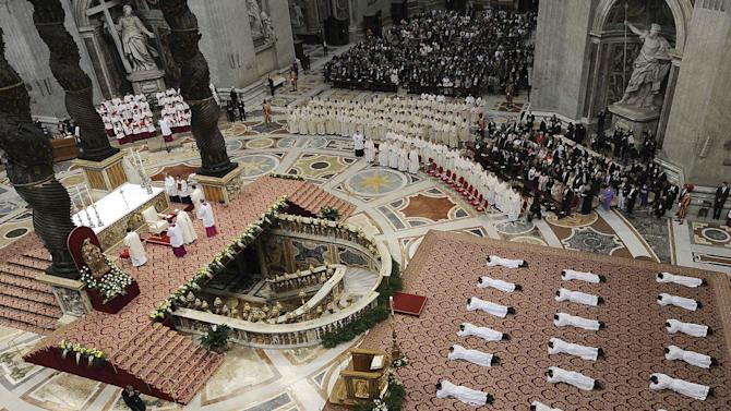 Pope Francis leads a mass to ordain 19 new priests in the St. Peter's Basilica at the Vatican