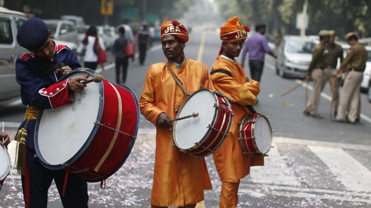 Members of a band play drums during the celebrations outside the headquarters of BJP in New Delhi