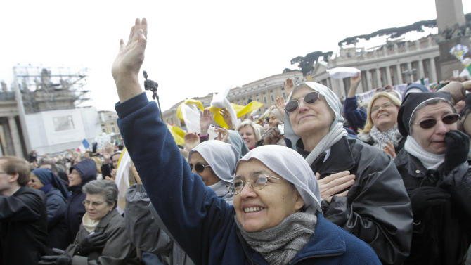 Faithful attend Pope Benedict XVI's last Angelus prayer,  in St. Peter's Square, at the Vatican, Sunday, Feb. 24, 2013. Benedict XVI gave his pontificate's final Sunday blessing from his studio window to the cheers of tens of thousands of people packing St. Peter's Square, but sought to reassure the faithful that he wasn't abandoning the church by retiring to spend his final years in prayer. The 85-year-old Benedict is stepping down on Thursday evening, the first pope to do so in 600 years, after saying he no longer has the mental or physical strength to vigorously lead the world's 1.2 billion Catholics. (AP Photo/Riccardo De Luca)
