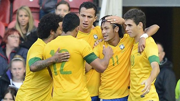 Brazil's Neymar (2nd R) celebrates scoring with teammates during their Olympic men's friendly soccer match against Team GB ahead of the London 2012 Olympic Games at the Riverside Stadium in Middlesbrough, northern England, July 20, 2012 (Reuters)