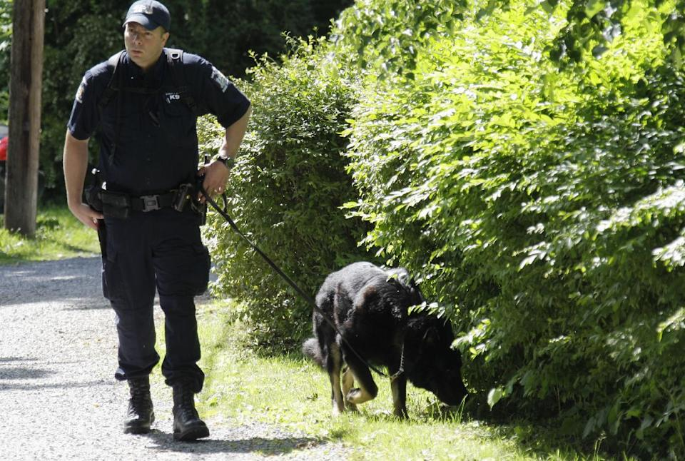 Law enforcement officers search near the home of Dr. Timothy Jorden in Hamburg, N.Y., Thursday, June 14, 2012. Jorden is sought in connection with the hospital shooting death of his ex-girlfriend at Erie County Medical Center in Buffalo, N.Y. on Wednesday.  (AP Photo/David Duprey)
