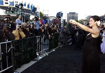 Premiere: Carrie Anne Moss issues commands to her adoring public throngs at the Hollywood premiere of Warner Brothers' The Matrix: Reloaded - 5/7/2003