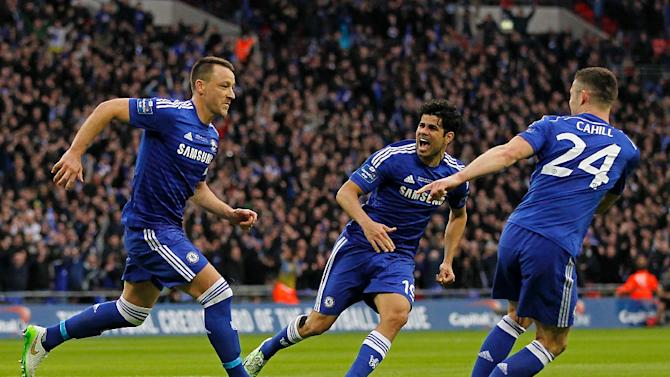 Chelsea's John Terry (L) celebrates scoring the opening goal with teammates Diego Costa (C) and Gary Cahill during their English League Cup final match against Tottenham Hotspur, at Wembley Stadium in London, on March 1, 2015