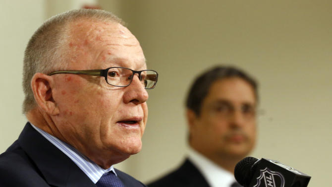 Jim Rutherford takes questions as Penguins president David Morehouse listens after Rutherford was introduced as the new GM on June 6, 2014, in Pittsburgh. (AP)