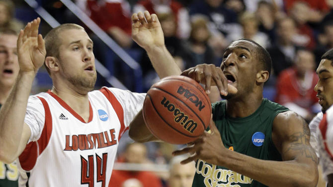 Colorado State forward Greg Smith, front right, loses control of the ball as he drives past Louisville forward Stephan Van Treese, front left, during a third-round NCAA college basketball tournament game on Saturday, March 23, 2013, in Lexington, Ky. (AP Photo/John Bazemore)