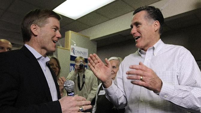 FILE - In this Jan. 21, 2012 file photo, Republican presidential candidate, former Massachusetts Gov. Mitt Romney talks with Virginia Gov. Bob McDonnell in Greenville, S.C. While Romney faults President Barack Obama for a weak American economy, Republican governors across the country are merrily trumpeting tales of business growth and falling employment. (AP Photo/Charles Dharapak, File)