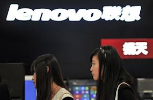 People walk past a Lenovo shop in Hefei, Anhui province