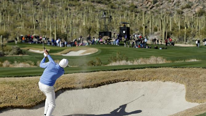 Matt Kuchar hits out of a bunker along the 14th fairway in the final round of play against Hunter Mahan during the Match Play Championship golf tournament, Sunday, Feb. 24, 2013, in Marana, Ariz. Kuchar won 2 and 1. (AP Photo/Ted S. Warren)