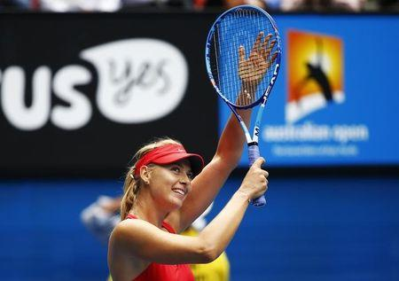 Sharapova of Russia celebrates after defeating Bouchard of Canada in their women's singles quarter-final match at the Australian Open 2015 tennis tournament in Melbourne