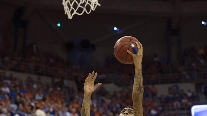 Florida guard Mike Rosario (3) shoots as Kentucky forward Nerlens Noel, left, and guard Ryan Harrow (12) watch during the first half of an NCAA college basketball game in Gainesville, Fla., Tuesday, Feb. 12, 2013. Florida won 69-52. (AP Photo/Phil Sandlin)