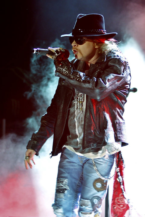 FILE - This Dec. 7, 2012 file photo shows Axl Rose, lead vocalist of Guns N' Roses performing during their concert in Bangalore, India. A judge on Wednesday Feb. 20, 2013 dismissed Rose's lawsuit agai