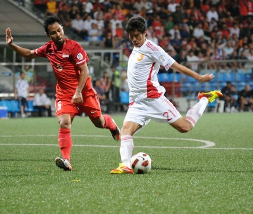 Yu Hai (right) scored a goal for China