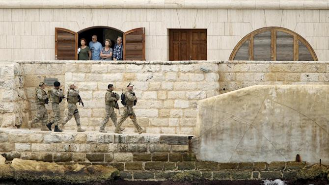 Soldiers patrol outside the St Angelo Mansions during the Commonwealth Heads of Government Meeting in Vittoriosa, near Valletta
