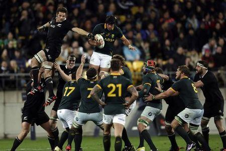South Africa's Springboks Whiteley and New Zealand's All Blacks McCaw fight for the ball in the line out during their Rugby Championship match at Westpac Stadium in Wellington