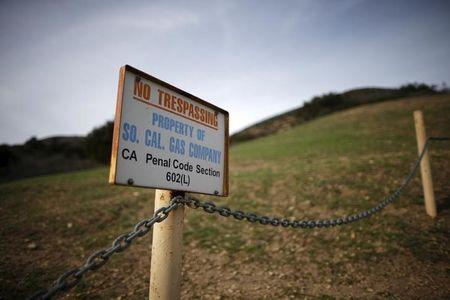 A gas company sign marks a fence near the site of the Aliso Canyon storage field where gas has been leaking in Porter Ranch