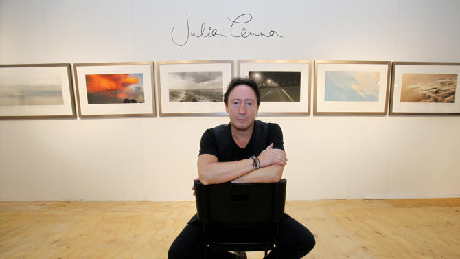 "Julian Lennon, son of the late Beatles legend John Lennon, poses in front of some of the photographs he is displaying in a show titled ""Alone"" at the Overture Art Fair, Monday, Dec. 3, 2012 in Miami. Art Basel Miami Beach and about two dozen other independent art fairs open Thursday. Tens of thousands of people are expected through Sunday at the fairs throughout Miami and South Beach. Lennon also exhibited his photography during the 2010 art fairs, and he was looking forward to enjoying Miami's social scene. ""You get every kind of character and every kind of style,"" he said. ""I just hope that doesn't detract from the actual work of the artists who've come here."" (AP Photo/Wilfredo Lee)"
