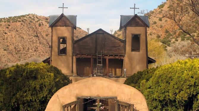 "In this March 26, 2013 photo, El Santuario de Chimayo in Chimayo, N.M. is shown as volunteers prepare for Easter Weekend. Around 50,000 pilgrims are expected to visit the shrine known as the ""Lourdes of America,"" and officials say more pilgrims may come just two weeks after the first pope from the Americas, Argentine-born Pope Francis, was elected. (AP Photo/Russell Contreras)"