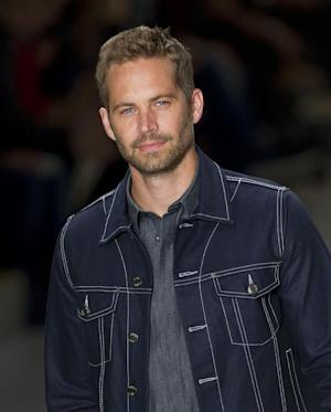 FILE - This March 21, 2013 file photo shows U.S. actor Paul Walker wearing a creation from the Colcci summer collection at Sao Paulo Fashion Week in Sao Paulo, Brazil. An attorney for Walker's mother delayed a hearing on a temporary guardianship for the late actor's 15-year-old daughter on Thursday March 27, 2014, to allow attorneys to try to work out an agreement for the teenager's care. (AP Photo/Andre Penner, File)