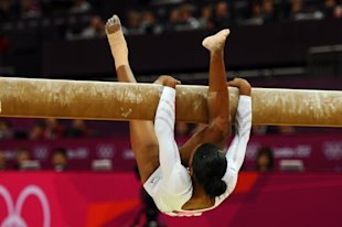 Gabrielle Douglas falls off the beam during the Artistic Gymnastics Women&amp;#39;s Beam final. (Getty Images)
