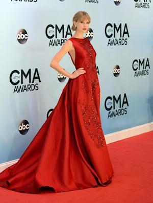 Taylor Swift arrives at the 47th annual CMA Awards at Bridgestone Arena on Wednesday, Nov. 6, 2013, in Nashville, Tenn. (Photo by Evan Agostini/Invision/AP)