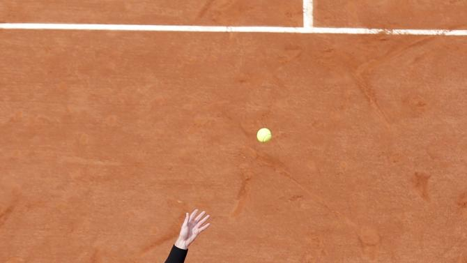 Andy Murray of Britain serves to Joao Sousa of Portugal during their men's singles match at the French Open tennis tournament at the Roland Garros stadium in Paris