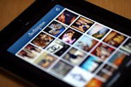 Instagram backed down Tuesday from a planned policy change that appeared to clear the way for the mobile photo sharing service to sell pictures without compensation, after users cried foul