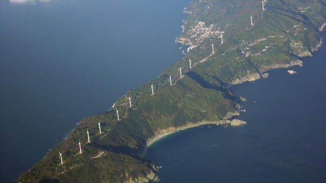 In this Dec. 2, 2011 photo, wind turbines belong to local wind farms stand along the 50-kilometer (31-mile)-long Sadamisaki Peninsula in Ehime Prefecture, western Japan. Another long, stupefyingly hot summer is looming for Japan just as it shuts down its last operating nuclear power reactor, worsening a squeeze on electricity and adding urgency to calls for a green energy revolution. On Saturday, May 5, 2012, the last of the country's 50 usable nuclear reactors will be switched off, completely idling a power source that once supplied a third of Japan's electricity. (AP Photo/Hiroshi Otabe)