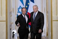 "French President Francois Hollande (L) and Israel's Prime Minister Benjamin Netanyahu arrive for a press conference at the Elysee Palace in Paris. Hollande on Wednesday said he wanted ""concrete acts"" from Iran to prove it was not pursuing nuclear arms, after his first direct meeting with Netanyahu"