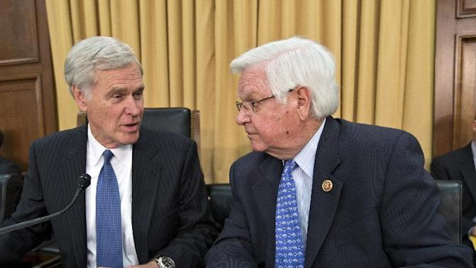"""FILE - In this June 3, 2013, file photo House Appropriations Committee Chairman Rep. Hal Rogers, R-Ky., right, talks with the chairman of the committee that funds the IRS, Rep. Ander Crenshaw, R-Fla., the House Financial Services and General Government subcommittee, on Capitol Hill in Washington during a hearing with acting IRS Commissioner Danny Werfel. Republicans have fought the health care law since it was enacted in 2010 without a single GOP vote. Now the IRS scandals are getting some Republicans a timely excuse to to starve it by refusing funding for its implementation. """"I think it's safe to say they're (IRS) not going to get the kind of increase they're asking for,"""" said Crenshaw, R-Fla. """"The question is, based on their bad behavior, are they going to end up with less money?"""" he said.  (AP Photo/J. Scott Applewhite, File)"""