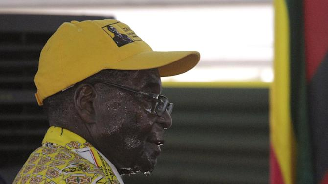 Zimbabwean President Robert Mugabe sweats as he leaves the podium after delivering his speech during the official opening of the Zanu pf 6th National Congress in Harare, Thursday, Dec. 4, 2014.  Mugabe attacked his deputy President Joice Mujuru aledging she plotted to remove him from power.(AP Photo/Tsvangirayi Mukwazhi)