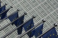 European flags flutter at the entrance of the European Commission's Berlaymont building in Brussels. European Union leaders are to discuss giving the bloc powers to amend the budgets of countries not keeping to EU fiscal rules at their summit later this week, Tuesday's Financial Times reported