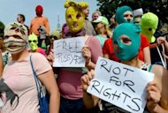 "Supporters of the Russian punk band ""Pussy Riot"" hold a rally in the German city of Hamburg in August 2012. A Russian court has issued an order to limit access to the videos of performances by the jailed feminist punk band, ruling the films to be extremist."