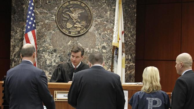 From left, DuPage State's Attorney Robert Berlin, Senior Assistant Public Defender Mike Mara, Elzbieta Plackowska, and interpreter Adam Kleczyngier, appear before DuPage County Judge Robert Kleeman  during Plackowska's arraignment Wednesday, Nov. 21, 2011 in Wheaton, Ill. Plackowska is charged with fatally stabbing her seven year old son and a five year-old girl she was babysitting. Plackowska appeared in court in a blue jail uniform and stood silently beside her public defender as he entered the not guilty pleas on her behalf during the brief hearing before Judge Robert Kleeman.(AP Photo/M. Spencer Green, Pool)